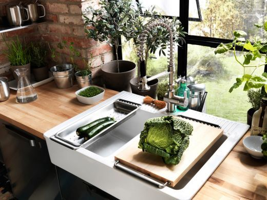 Ikea sink, faucet, cutting board and draining board. . . not bad ...