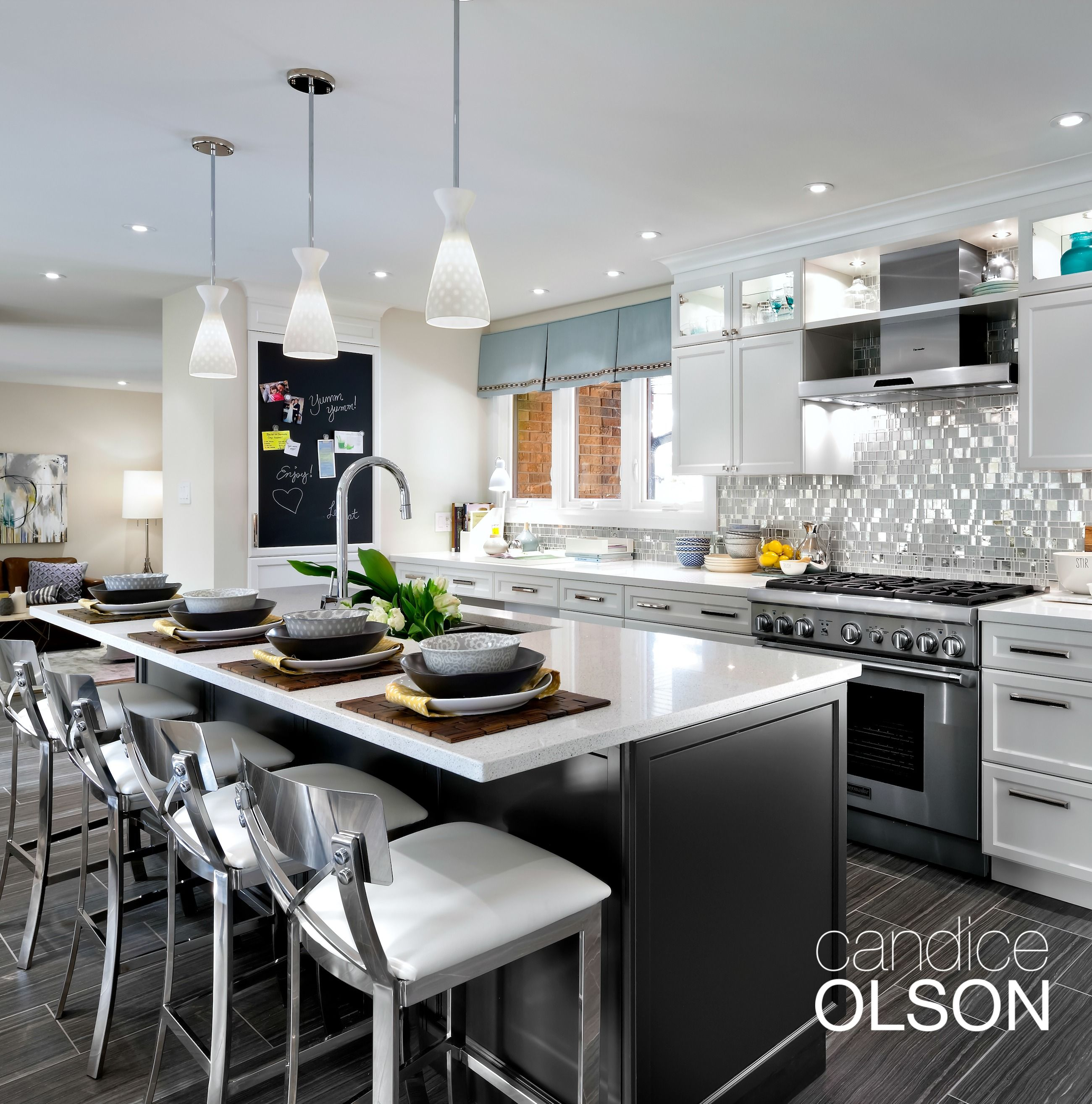A large island offers ample counter seating. Unobtrusive yet ...