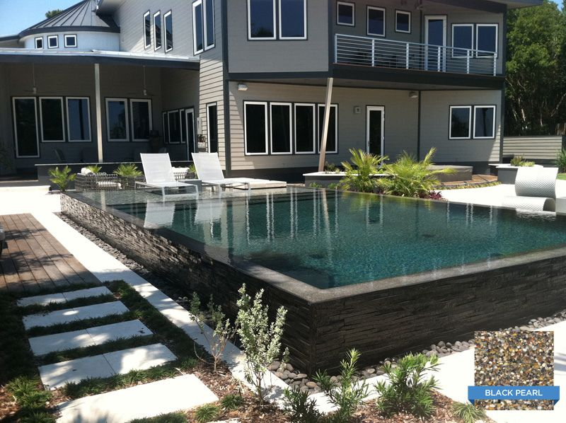The Surrounding Decor Of This Pool Match Perfectly With Sunstone Pearl Black Pearl Pool Designed Built And Swimming Pool Pictures Swimming Pools Pool Picture