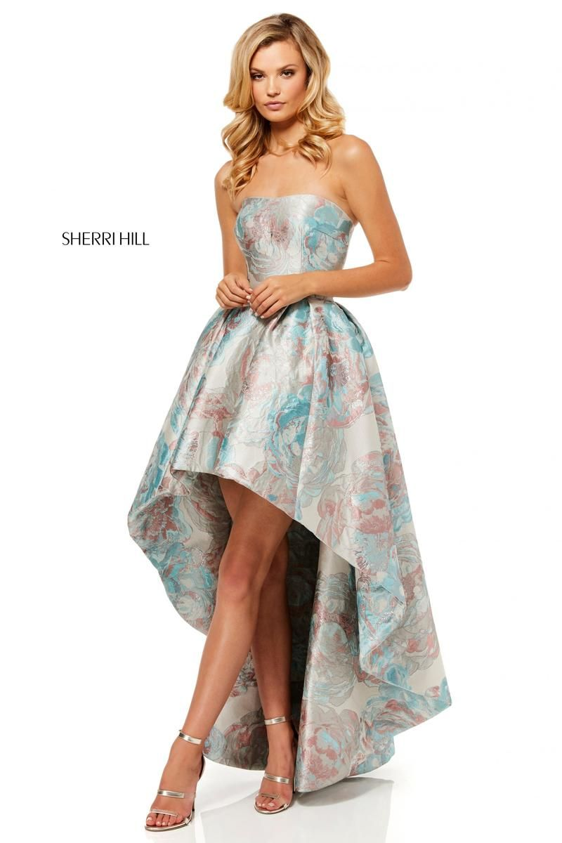 fcd4e7e1136 Style 52143 from Sherri Hill is a high low strapless prom gown in a muted  floral