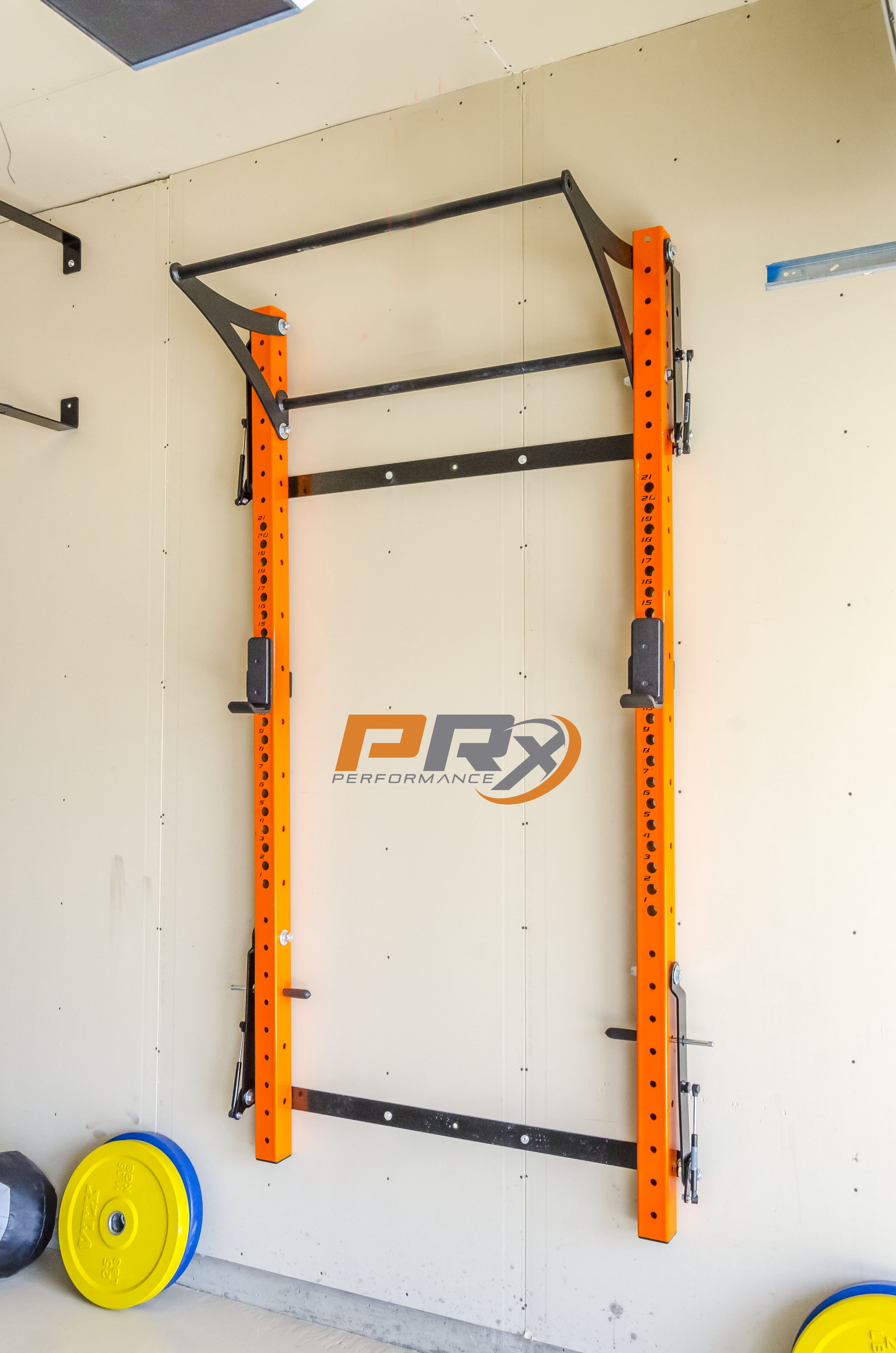 The Space Saving Squat Rack All Folded Up And Out Of The