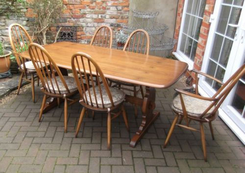 Good ercol golden dawn refectory table six quaker chairs with