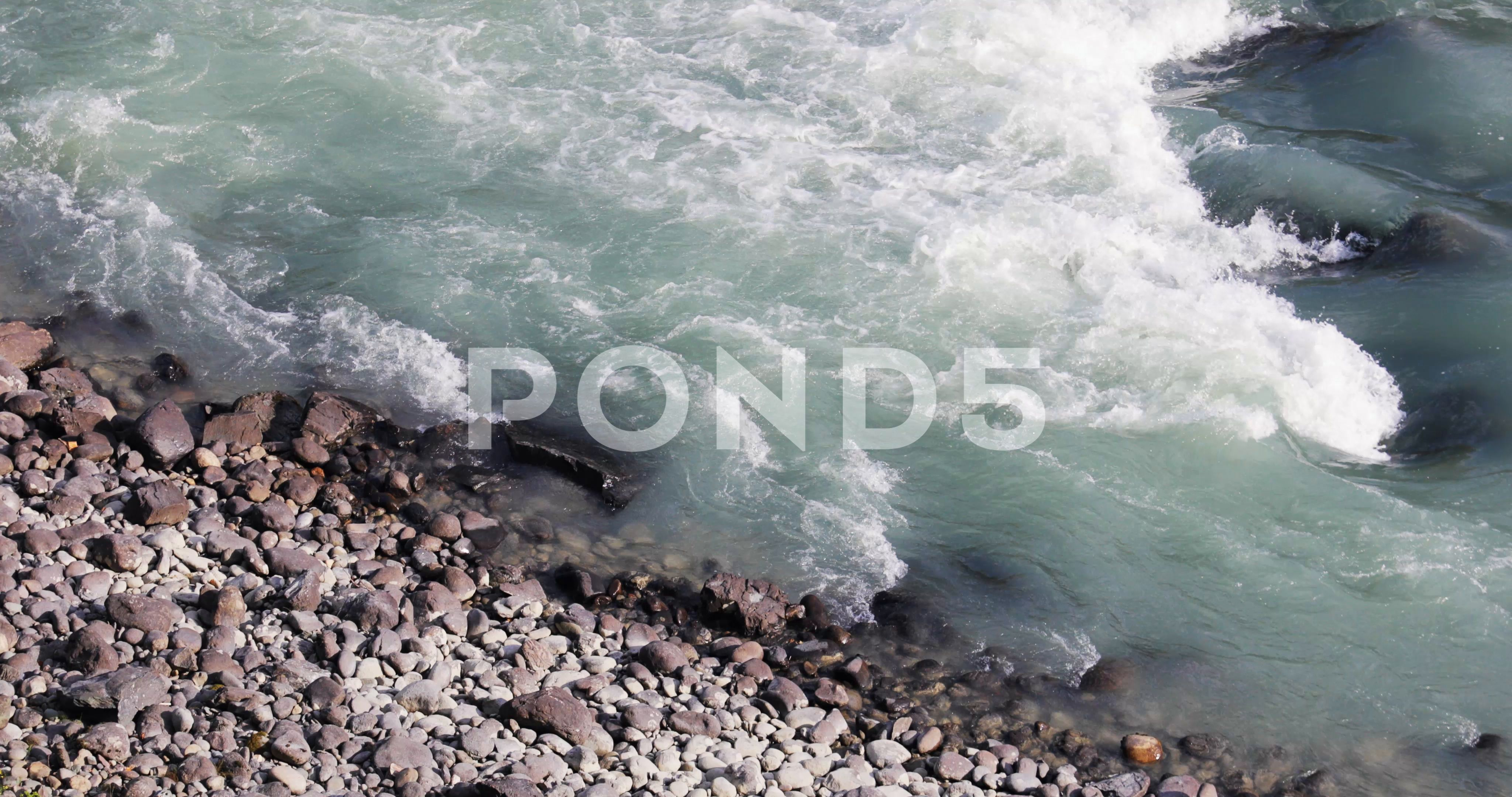 Fast flow of water with foam in wild nature near waterfall in mountain river Stock Footage foamwildwaterFast