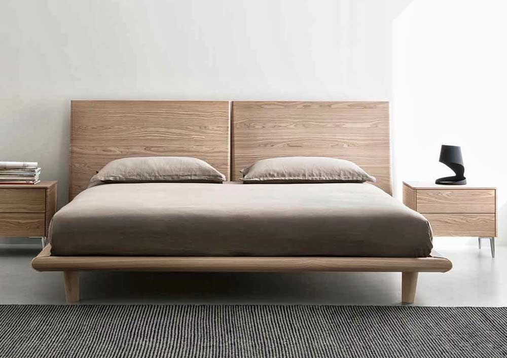 A Gorgeous Modern Bed Characterized By A Wooden Headboard Divided