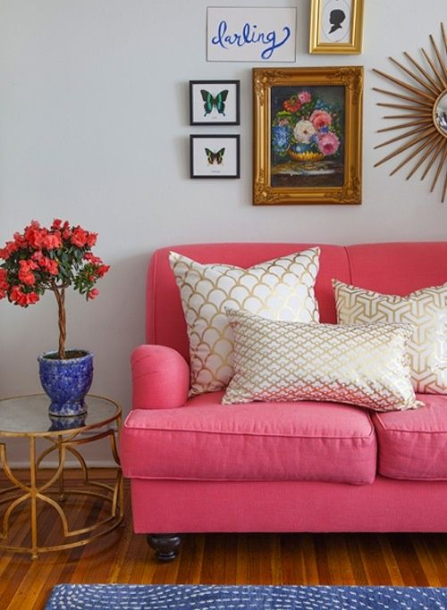 Bright solid color couch with cute pillows that go with wall decor ...