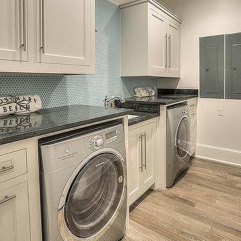 Ivory Mudroom Cabinets with Blue Oval Tile Backsplash
