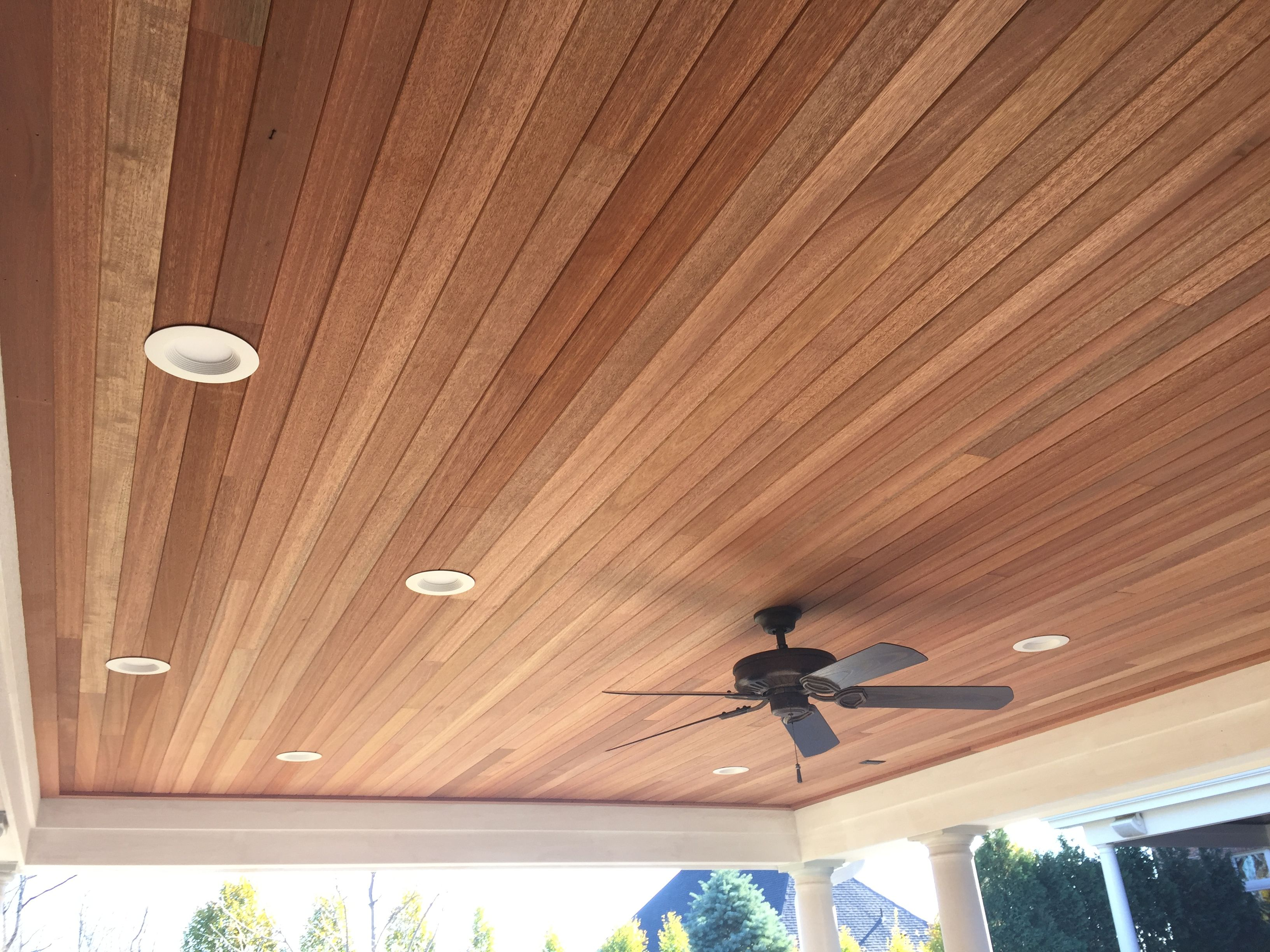 Gorgeous mahogany tongue and groove ceiling for an outdoor
