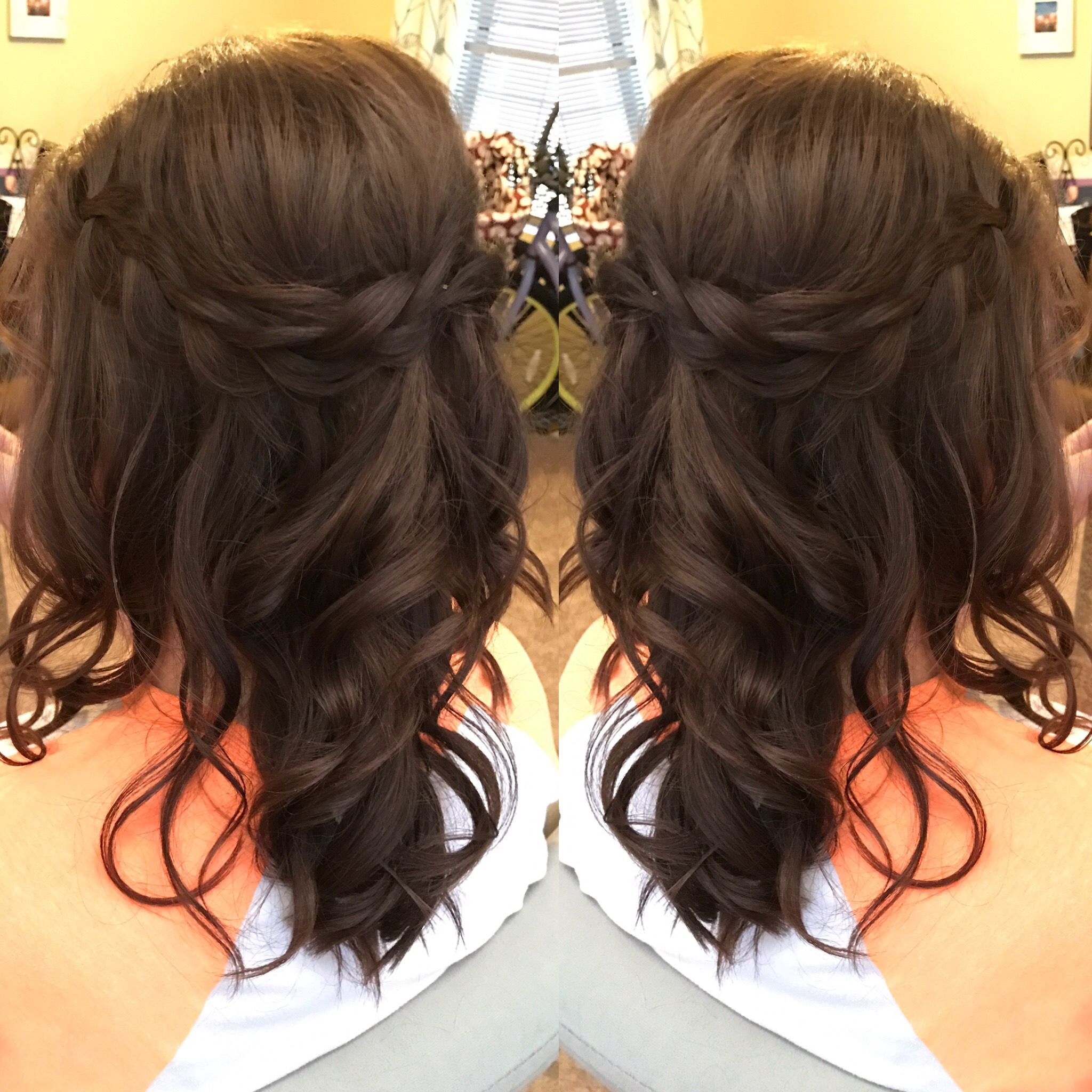 Loose curls updo half up half down hairstyle brunette