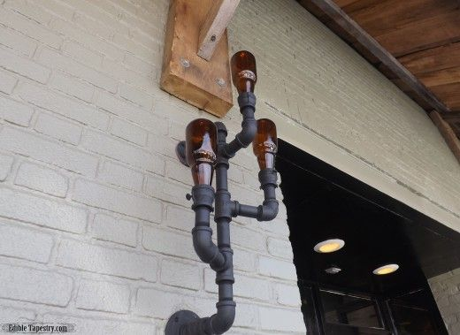 Lights made from pipe works and amber beer bottles.