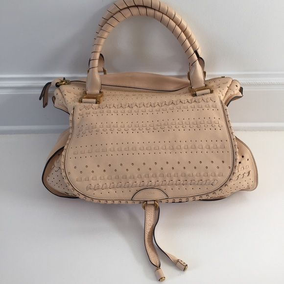 Large Marcie Chloè purse in tan Never used. In perfect condition, no stains or wholes. Has a phone pocket as well as a zipper pocket inside bag. Flap pocket on front. Beautifully detailed on front. Gold hardware. Made in Italy. Chloe Bags Totes