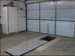 Storm shelters alabama photo 12259485 bg3 for Garage safe room