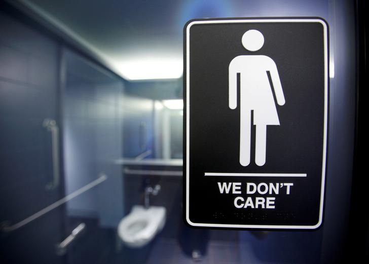 USA-LGBT/ A sign protesting a recent North Carolina law restricting transgender bathroom access is seen in the bathroom stalls at the 21C Museum Hotel in Durham, North Carolina May 3, 2016. Across the country, state legislatures are considering bills that would allow citizens to deny services to members of the LGBT community on religious grounds. But advocacy groups, business executives, politicians and entertainers are standing up to condemn such laws. Here are the major moments in this…