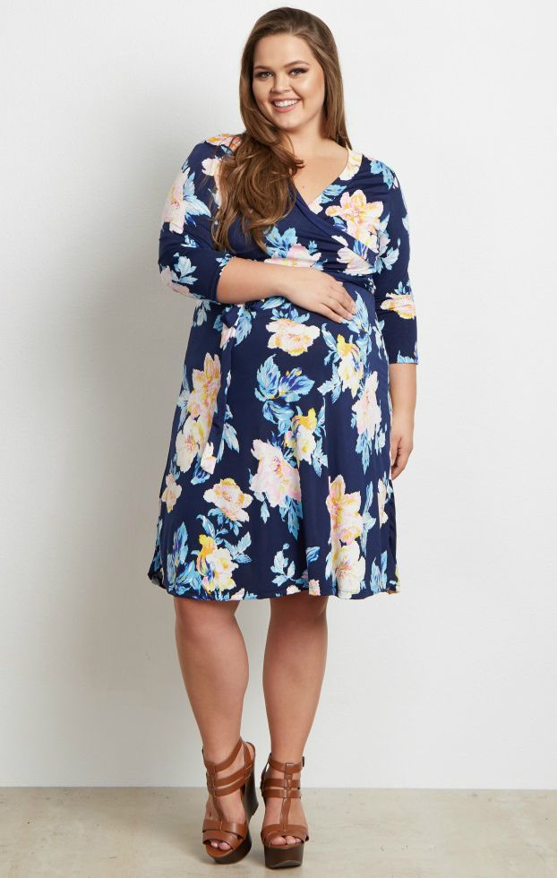 2f3ccf9b619 This gorgeous floral wrap plus size maternity dress is everything we need  this season. A floral print just in time for spring