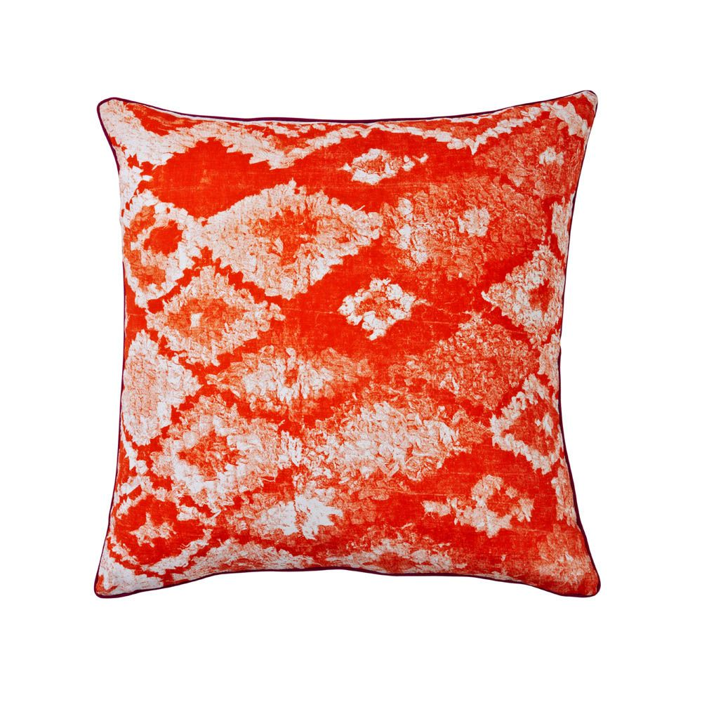 linen cushion hand screen printed with carpet design in orange