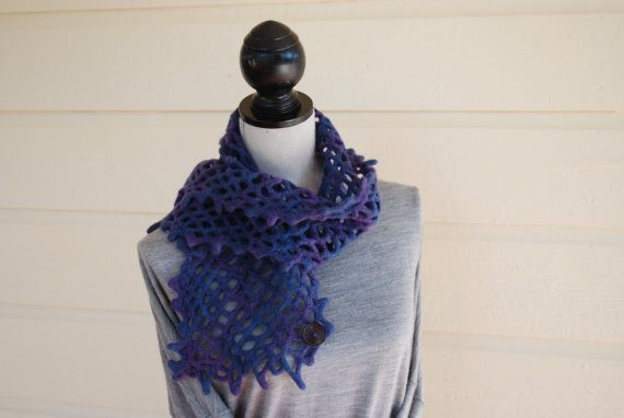 I crocheted and felted this scarf using 100% Merino Wool yarn. It has the wonderful real wool feel to it, but its softer than many other type of