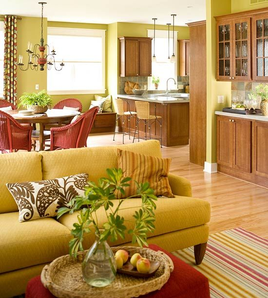 So warm and happy color theme in yellow green red with wood cabinets livingroom dining room kitchen also rh pinterest