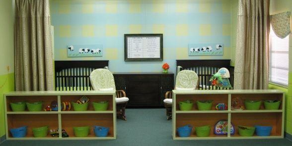 Church Nursery, love the two bookcases separating the