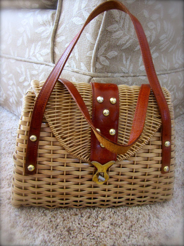 Vintage Retro Woven Basket Purse Handbag Straw Made in British Hong Kong Leather Handles. $24.99, via Etsy.