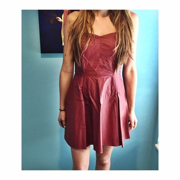 Burgundy Faux Leather Strapless Skater Dress Faux leather dress. I wore it once and it's been in my closet since. I'm absolutely in love with it but unfortunately it's big on me. It's a perfect piece for fall and winter, plus leather is so in! Note: Tagged Nasty Gal for exposure ❤️ Nasty Gal Dresses