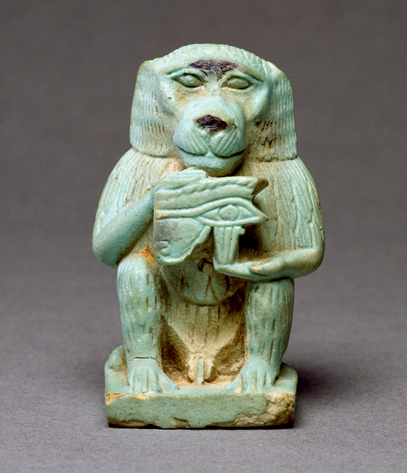 """Egyptian Faience Thoth Baboon, Late Period, 664-332 BCFrom the beginning of Egyptian history, the baboon had a role in Egyptian religion. Initially, he was known as a deity called the """"Great White One"""" (that is, the moon), but soon this god was conflated with Thoth, the better known ibis-headed god of writing and recording. Thoth's responsibilities included the calendar, which in ancient Egypt was lunar based, facilitating the integration of the two deities. Baboon amulets probably were…"""