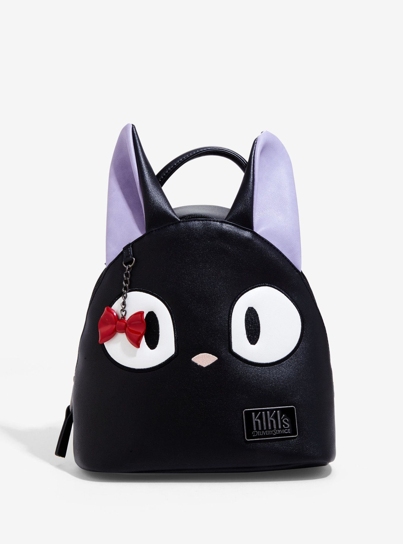 5b8f5f0c3d28 You favorite companion cat has been turned into a mini backpack! This black mini  backpack features Jiji s adorable face and a dangling bow bag charm!