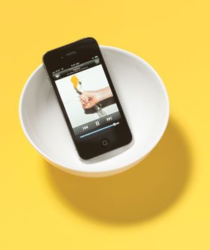 Place your iPhone in a bowl and crank up the volume. The concave shape of the bowl will amplify the music.  Oh?