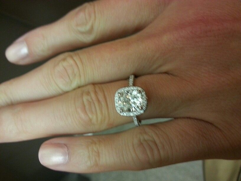 My cushion cut diamond ring with pave halo