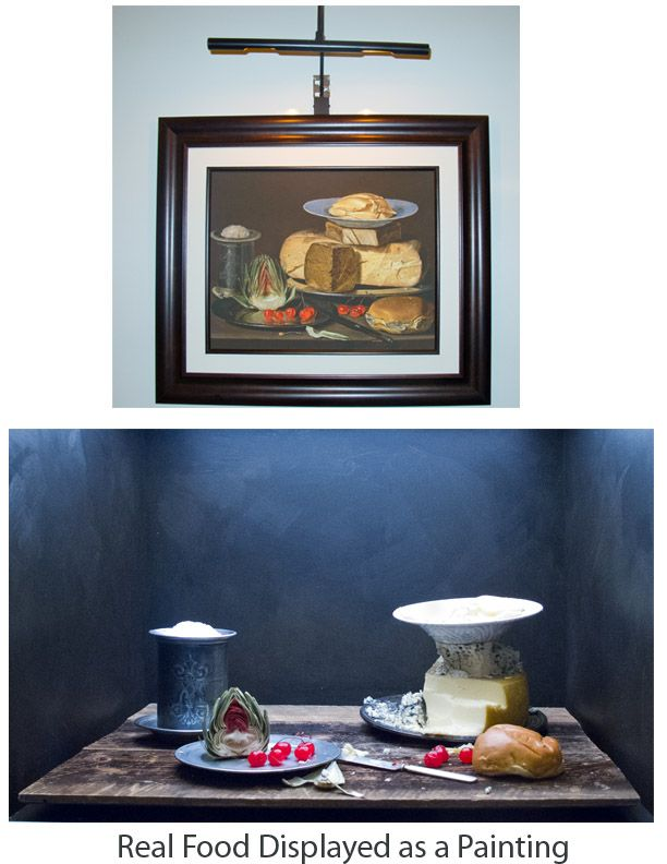 Real life cheese display imitates a painting. Artichoke, cherries, bread and cheese.