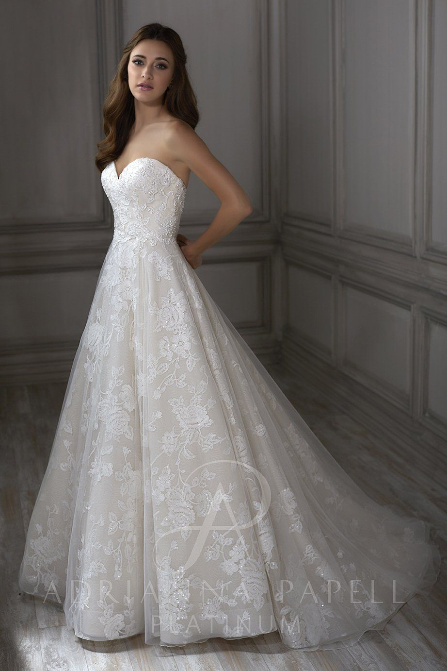 Claire:Floral lace appliques on this romantic lace ball gown ...