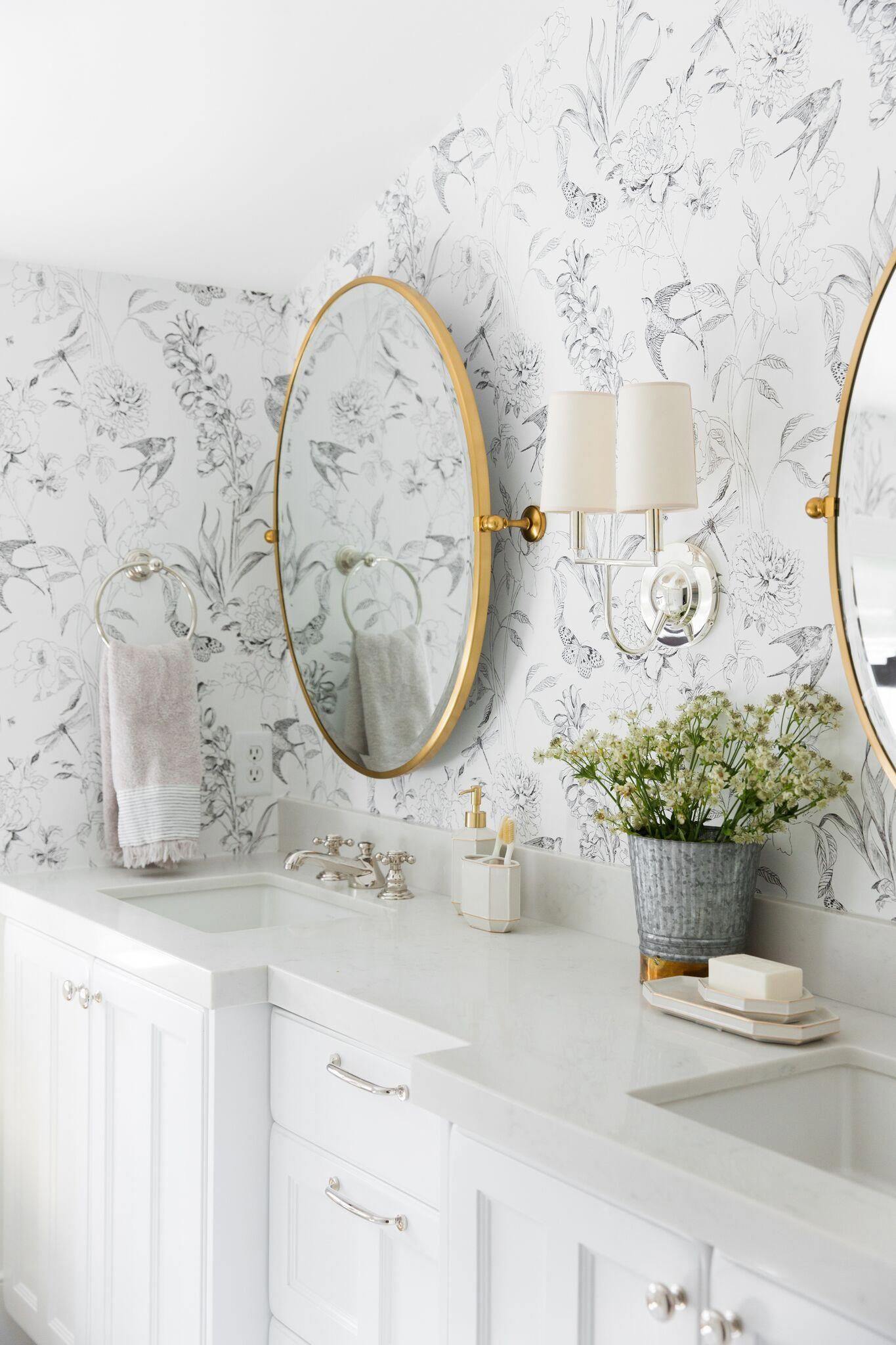 Photo of A whimsical, neutral kid's bathroom with mixed metals and wallpaper | Studio McG…