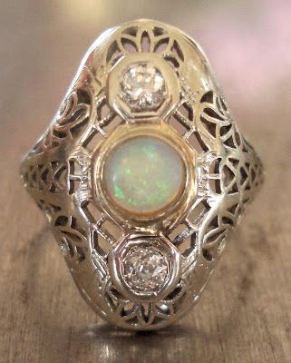 Antique Diamond and Opal Edwardian Ring. Via Diamonds in the Library.