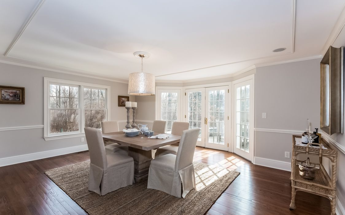Formal Dining Room With French Doors Leading Out To Patio Provides The Perfect Setting For Entertaining