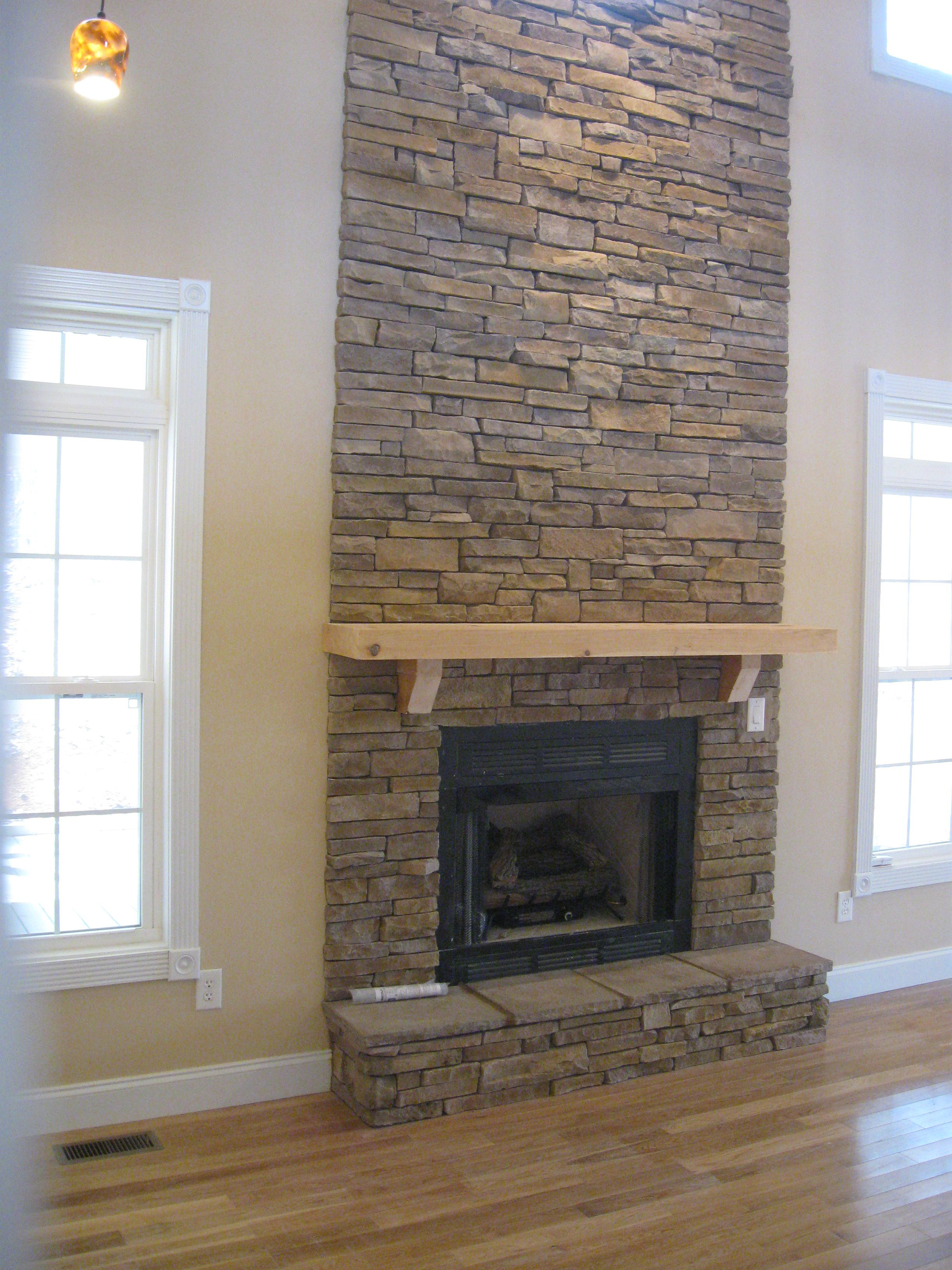 We accented this stone fireplace with a large mirror and a model
