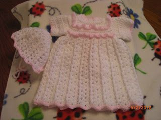Pink Ruffled Gown   Lions Brand Baby Soft Yarn - White and pink, size g hook.   Shell: 2 dc, ch 1, 2 dc in ch 1 space; Fpdc: Front Post DC....