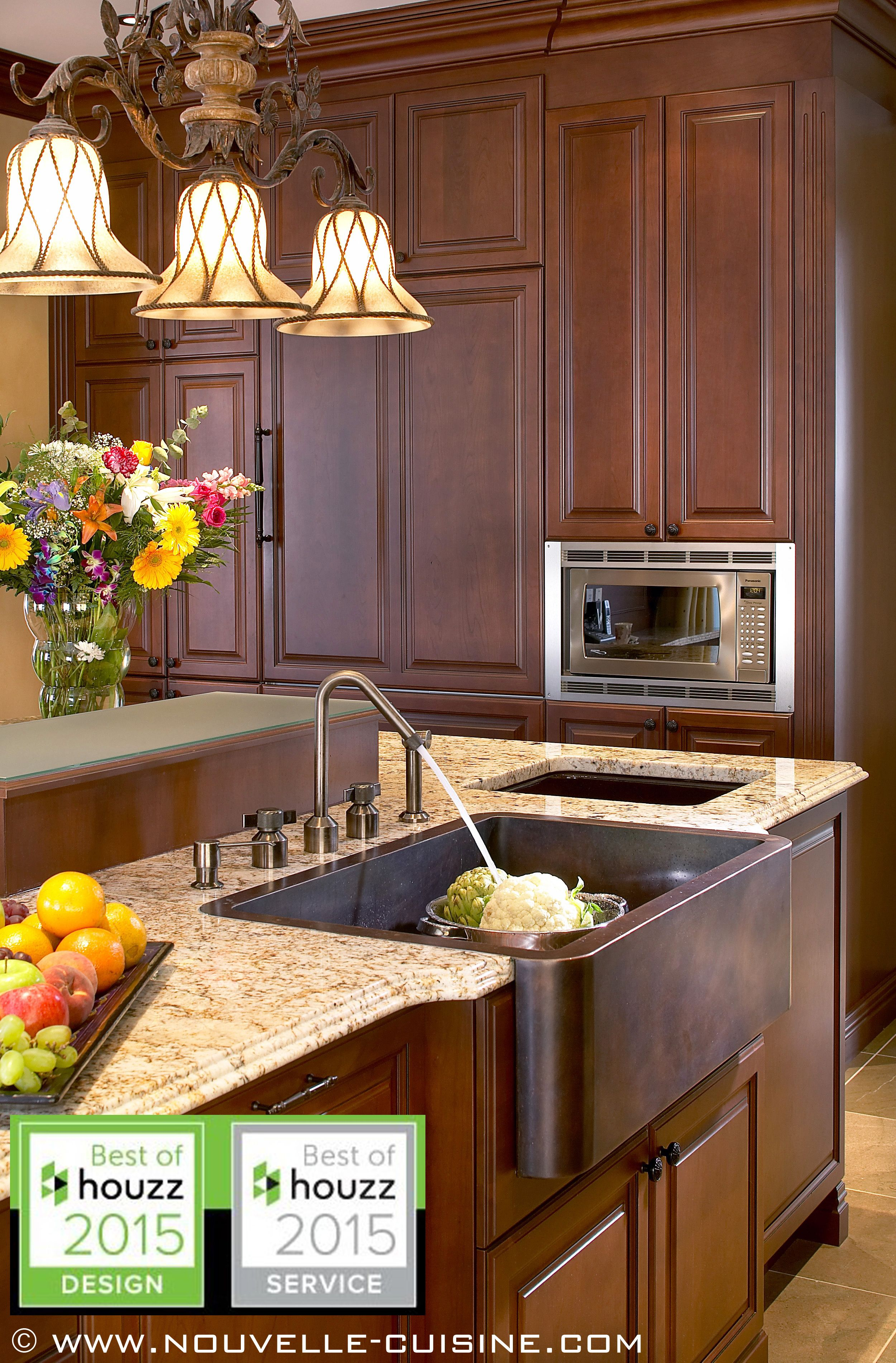 classic kitchen with wood cabinets and a granite countertop that extends onto the backsplash