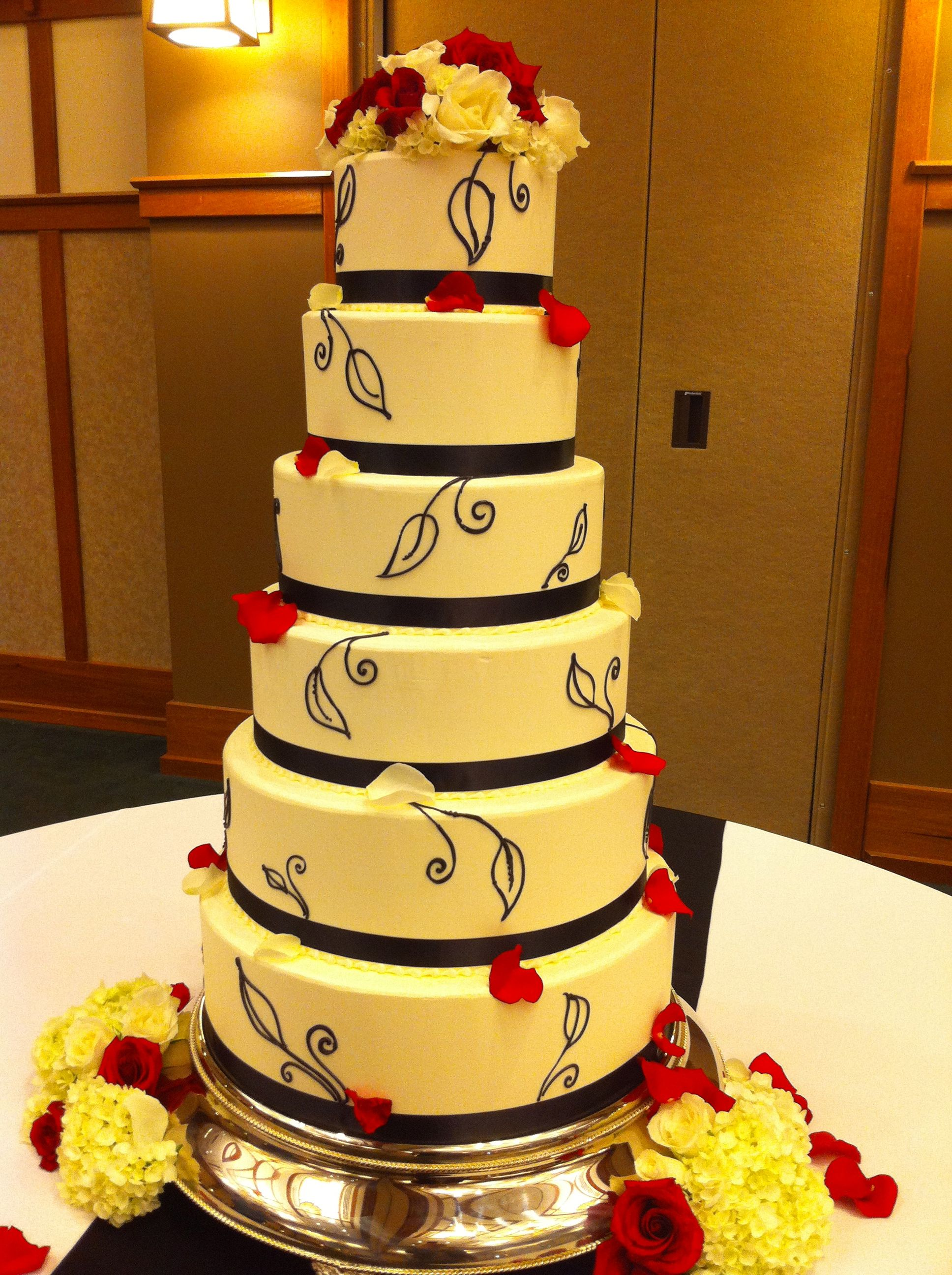 Magpies Bakery Knoxville  TN Buttercream wedding cake adorned with     Magpies Bakery Knoxville  TN Buttercream wedding cake adorned with satin  ribbon  buttercream piping and floral finish   wedding  satin  ido   knoxville