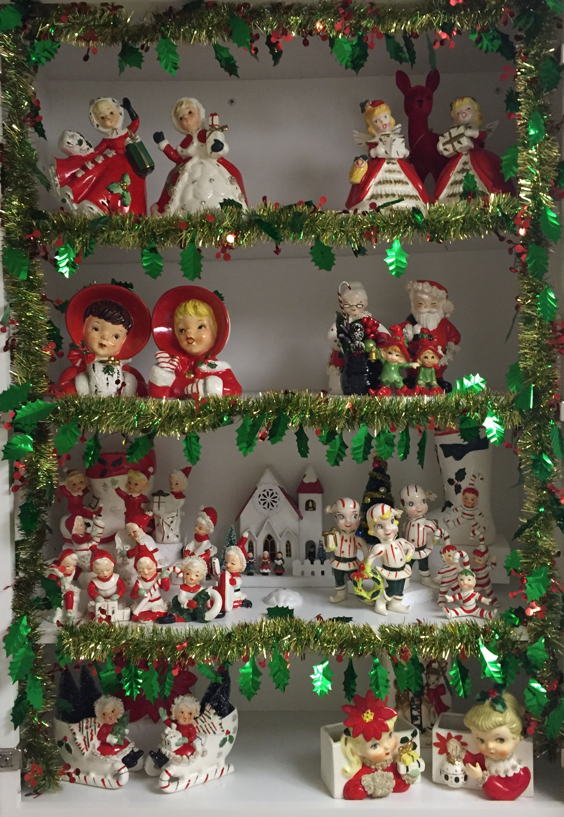 Old Christmas Decorations.Vintage Christmas Figurine Collection Display Old