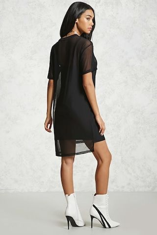 "A sheer mesh knit t-shirt dress featuring a front ""No Rules"" graphic on the cami dress underlay, a round neckline, short sleeves, and a high-low hem."