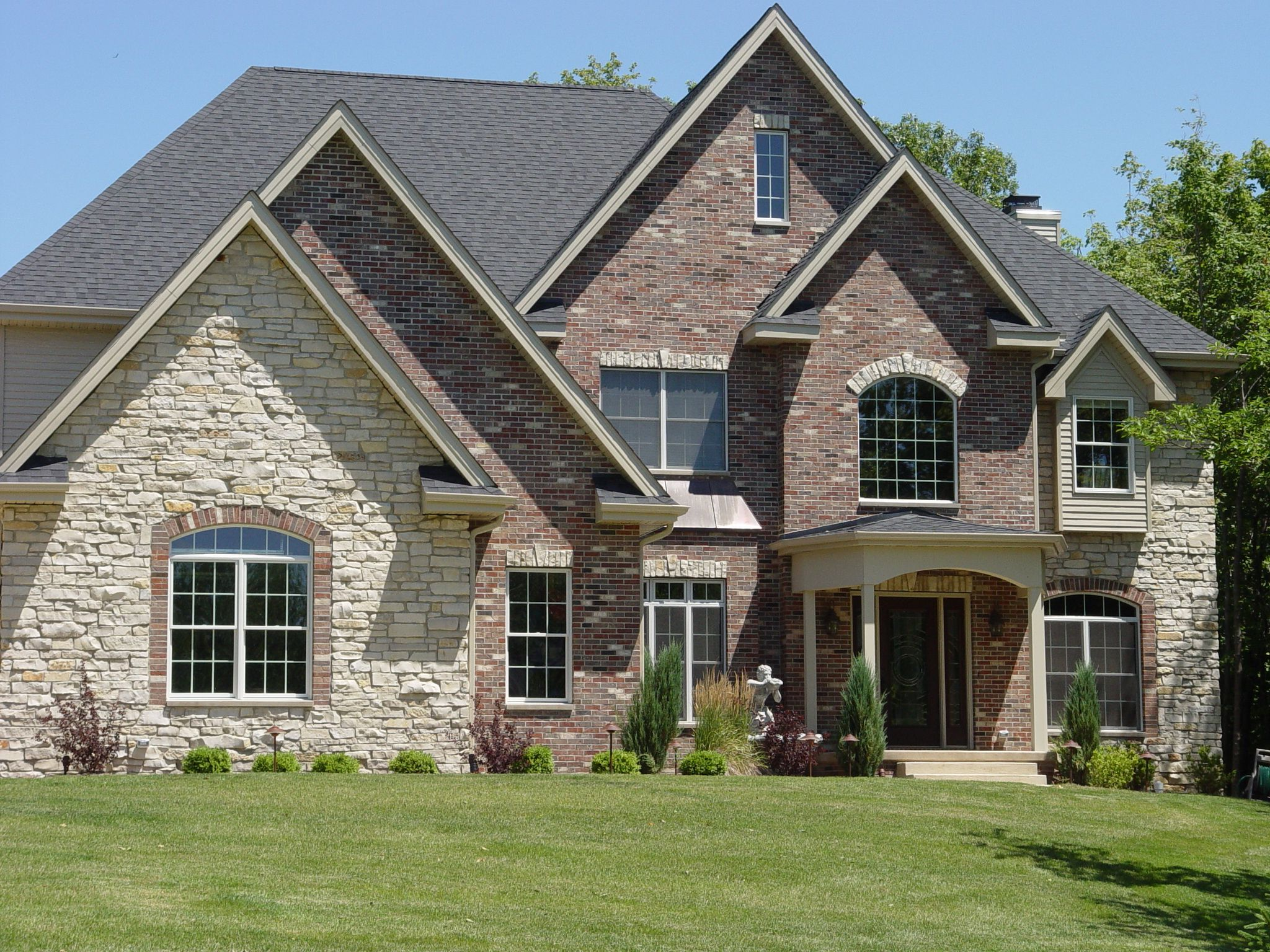 The Classic American Home Red Brick And Stone Lake Houses Exterior House Exterior Traditional House