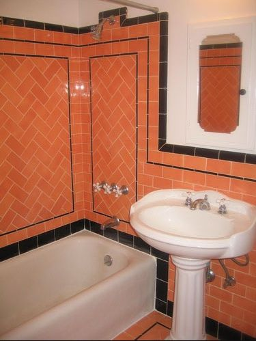 Salmon and black vintage tiles with pedestal sink so for Salmon bathroom ideas