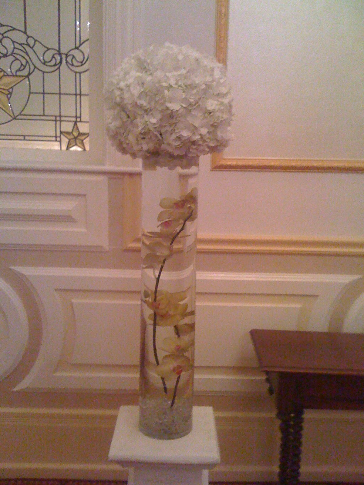 Gold Phalaenopsis Orchids Submerged Inside Vase Mounted With A Pomander Ball Of White Hydrangeas Green