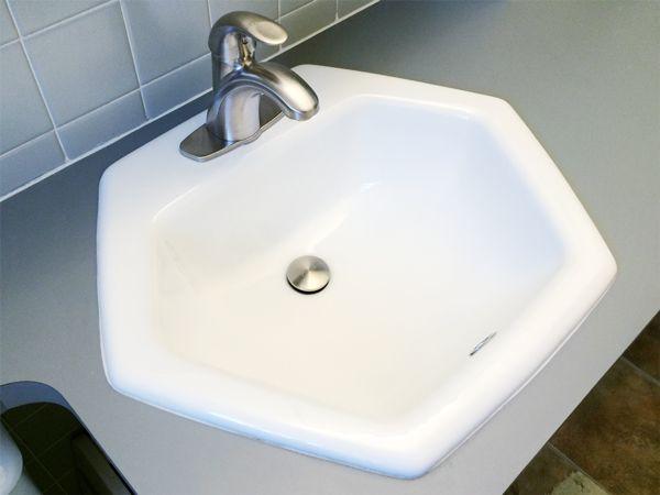 A Modern Bathroom Faucet Meets A Vintage Hexagon Sink