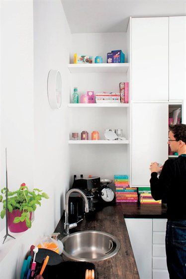 White Kitchen With Open Shelves And Dark Countertops Live From