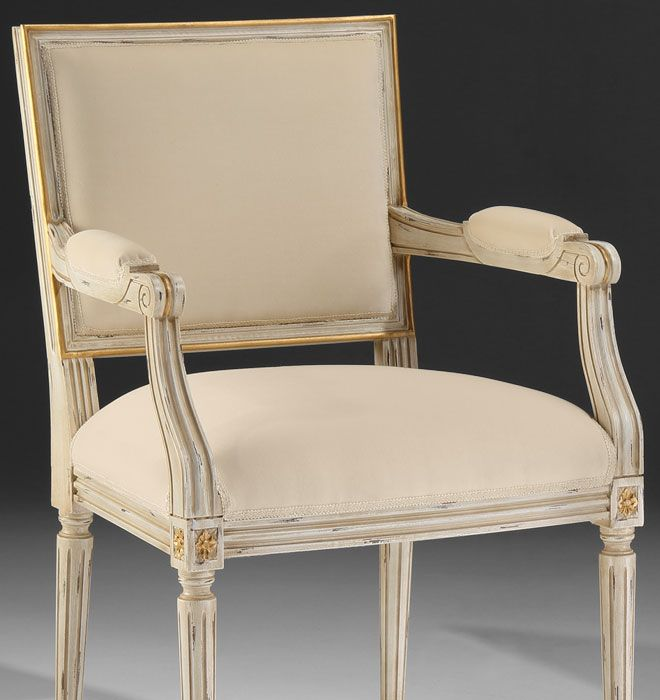 Hand-crafted Louis XVI style carved beech wood chairs in distressed white  finish. Chairs have antique gold leaf trim and off-white upholstery.