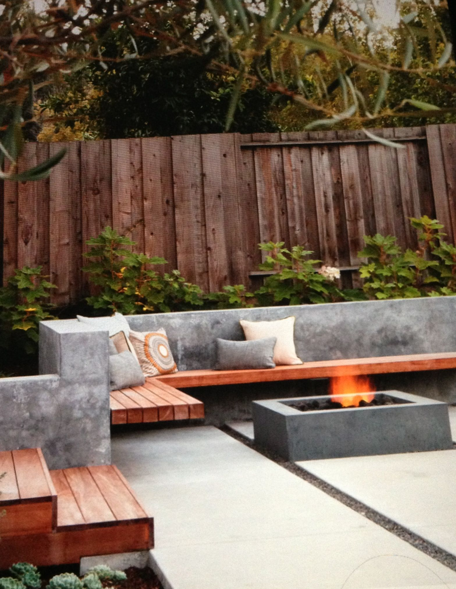 Sleek modern patio - concrete and wood | Small backyard ... on Modern Concrete Backyard id=49670