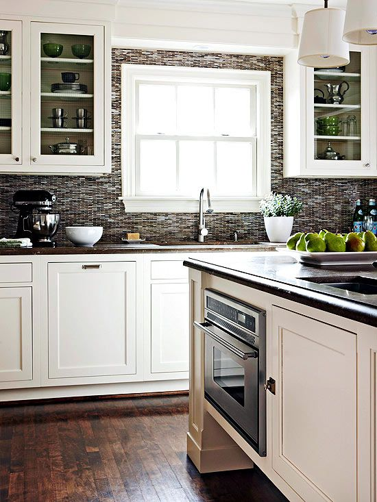 Contrasting Kitchen. White cabinets and dark grey backsplash ...