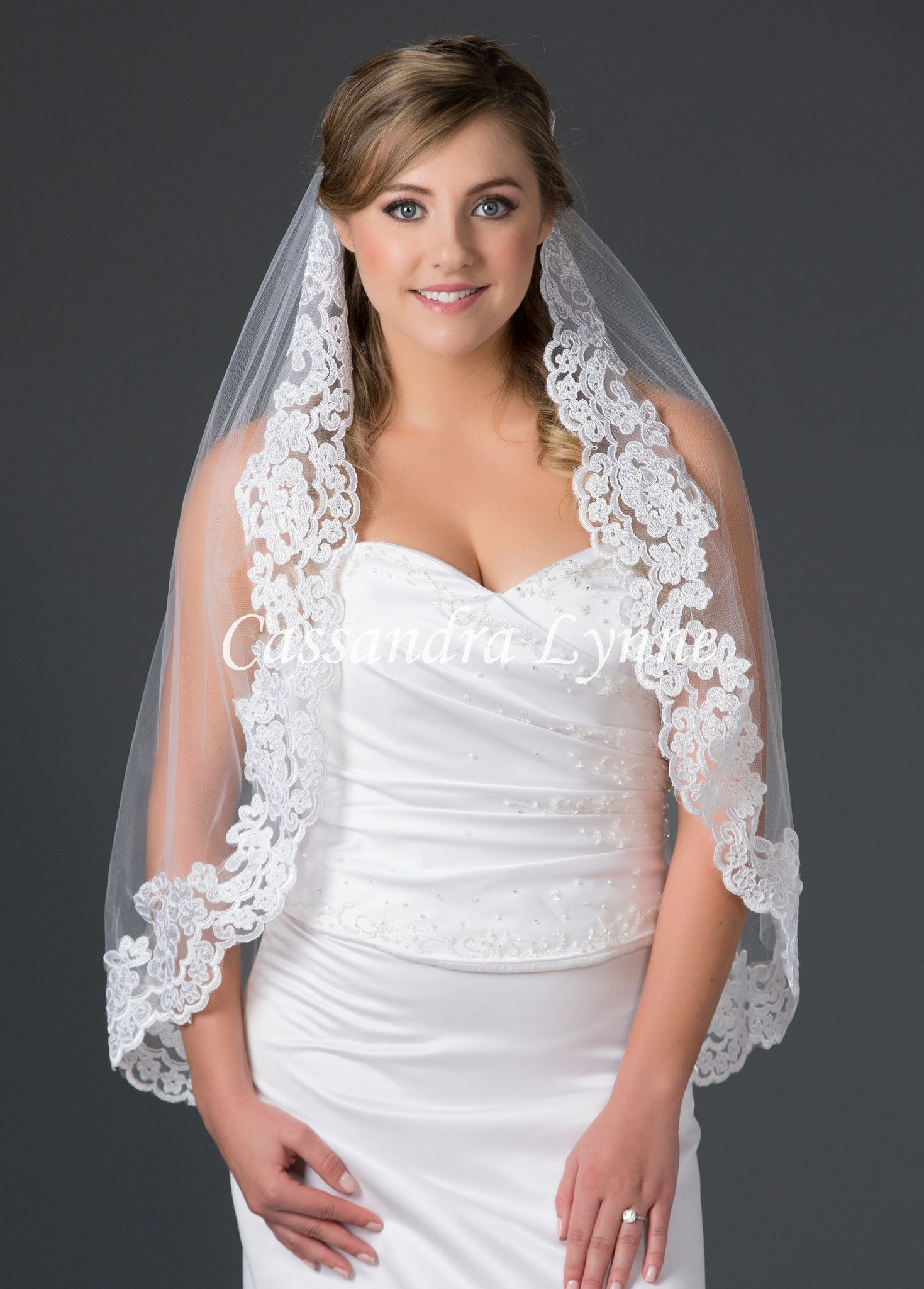 An elegant, custom made bridal veil with a 3.75 inch wide floral ...
