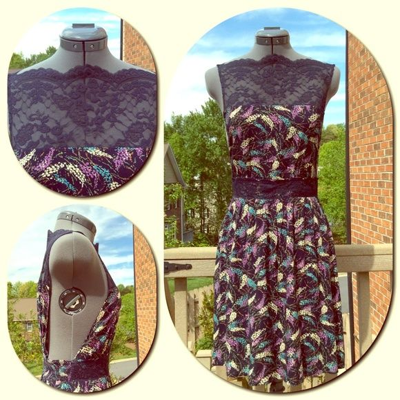 Free People Elegant Navy Floral Print Dress Free People Elegant Navy Floral Print Dress. Navy scalloped lace on the neck to bodice front and back. Also navy lace trim across the front at the waist. The floral print is navy background with teal/lavender and cream with a hint of brown and green. Cut out sides from shoulder to waist makes this very unique. Light gathering around the skirt and elastic smocking across the back and sides at the waist. Fabric: Shell 100% Rayon and Lace is 100%…