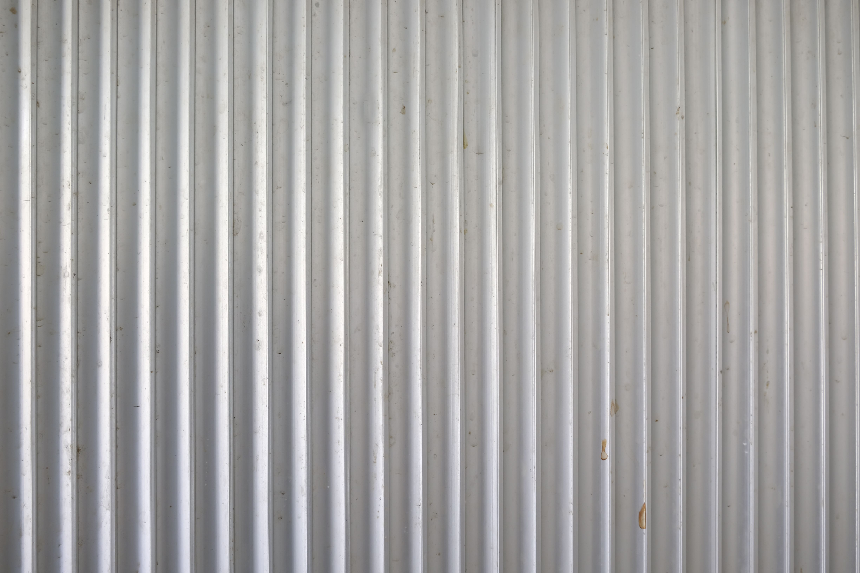 How To Install Corrugated Metal Walls Hunker Corrugated Metal Wall Corrugated Metal Siding Metal Walls Diy