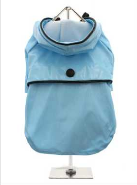 Protect your pup from the rain with this waterproof raincoat. The adjustable draw string hood will keep the raincoat snug to your pup's face, while the soft lining will keep your dog comfortable. The velcro fastenings make it easy to put on and take off your pup. This duck egg blue raincoat is trimmed with black piping and has matching black button and toggles.